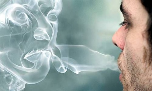 Man-blowing-smoke1